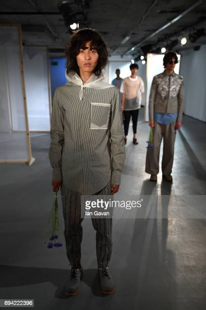 Models showcase designs at the BODYBOUND presentation during the London Fashion Week Men's June 2017 collections on June 9 2017 in London England