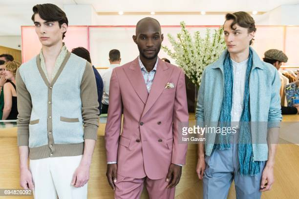 Models showcase designs at the Richard James presentation during the London Fashion Week Men's June 2017 collections on June 11 2017 in London England