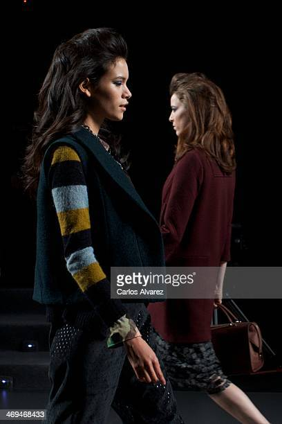 Models showcase designs by Ailanto on the runway at Ailanto show during Mercedes Benz Fashion Week Madrid Fall/Winter 2014 at Ifema on February 15...
