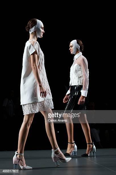 Models showcase designs by Ana Loking on the runway at Ana Loking show during Mercedes Benz Fashion Week Madrid Spring/Summer 2015 at Ifema on...