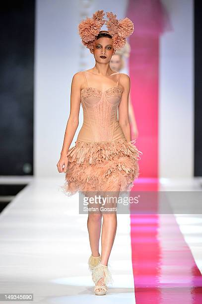 Models showcase designs by Aurelio Costarella on the catwalk during StyleAID 2012 at the Burswood Entertainment Complex on July 27, 2012 in Perth,...