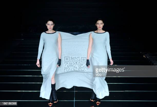Models showcase designs by Chen Jianping on the runway at the QIAODAN Chen Jianping Sports Wear Collection show during Mercedes-Benz China Fashion...