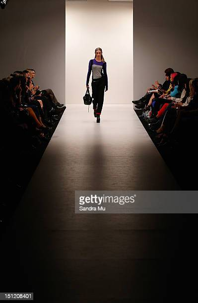 Models showcase designs by Company of Strangers at the New Zealand Fashion Week Autumn/Winter 2013 on September 4, 2012 in Auckland, New Zealand.