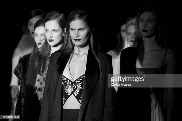 Models showcase designs by Duyos on the runway at Duyos show during Mercedes Benz Fashion Week Madrid Fall/Winter 2014 at Ifema on February 14 2014...