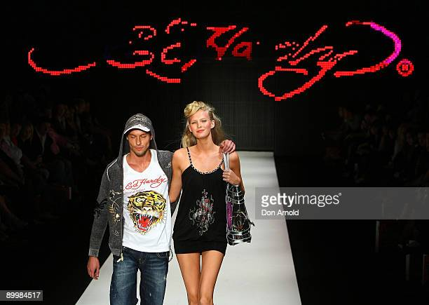Models showcase designs by Ed Hardy during the Ed Hardy Group Show show on the catwalk at Rosemount Sydney Fashion Festival 2009 at Martin Place on...