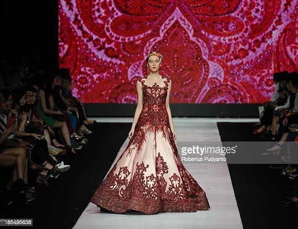 Models showcase designs by Imelda Kartini on the runway at the Esmod Jakarta show during Jakarta Fashion Week 2014 at Senayan City on October 21 2013...