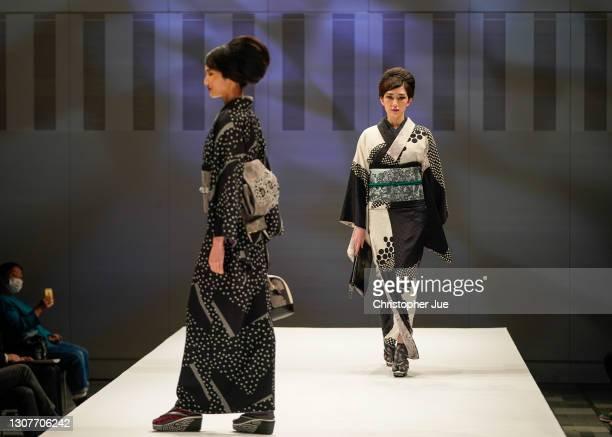 Models showcase designs by JOTARO SAITO on the runway during Rakuten Fashion Week TOKYO 2021 autumn/winter at Omotesando Hills Space O on March 18,...