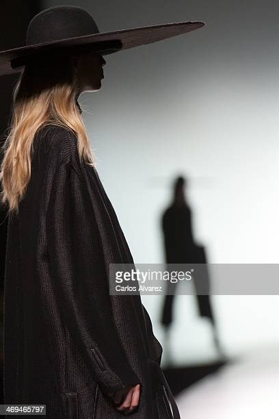 Models showcase designs by Martin Lamothe on the runway at Martin Lamothe show during Mercedes Benz Fashion Week Madrid Fall/Winter 2014 at Ifema on...