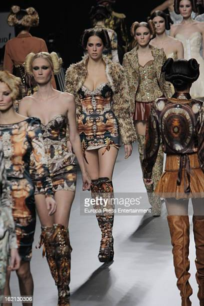 Models showcase designs by Maya Hansen on the runway at the Andres Sarda show during Mercedes Benz Fashion Week Madrid Fall/Winter 2013/14 at Ifema...