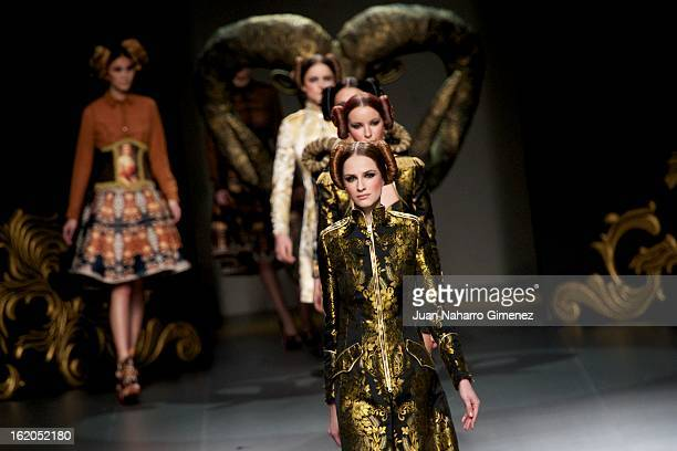 Models showcase designs by Maya Hansen on the runway during Mercedes Benz Fashion Week Madrid Fall/Winter 2013/14 at Ifema on February 18, 2013 in...