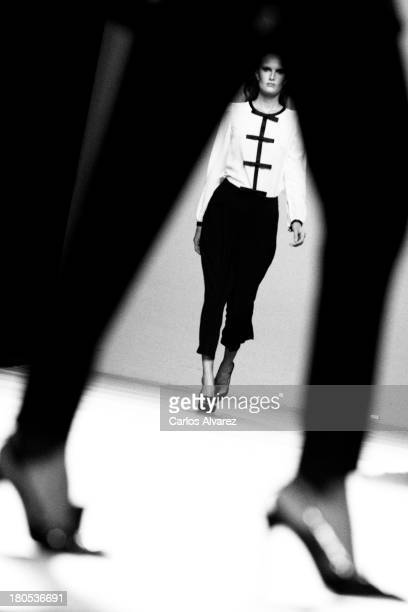 Models showcase designs by Miguel Palacio on the runway at Miguel Palacio show during Mercedes Benz Fashion Week Madrid Spring/Summer 2014 at Ifema...