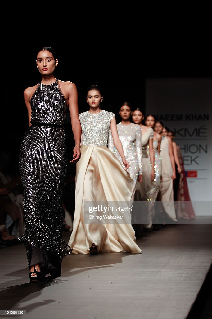 Models showcase designs by Naeem Khan on the runway during day two of the Lakme Fashion Week Summer/Resort 2013 on March 23, 2013 at Grand Hyatt in Mumbai, India.