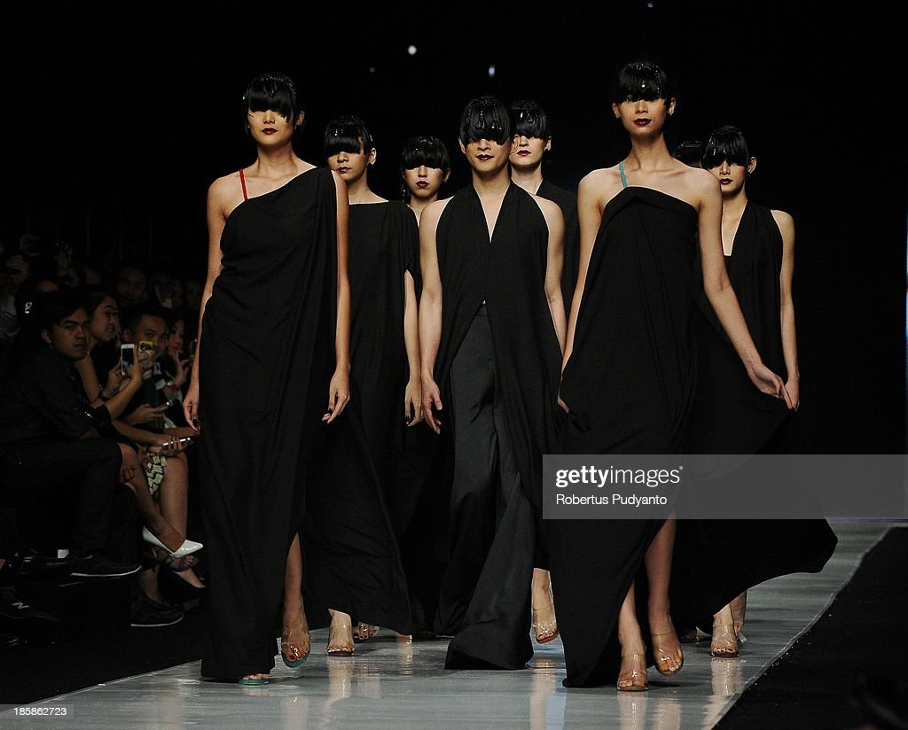 Models showcase designs by Oscar Lawalata on the runway at the Couture My Name is Andromeda show during Jakarta Fashion Week 2014 at Senayan City on October 25, 2013 in Jakarta, Indonesia.