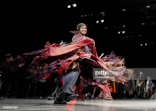 Models showcase designs by RequaL≡ on the runway during Rakuten Fashion Week TOKYO 2021 autumn/winter at Omotesando Hills Space O on March 20, 2021...