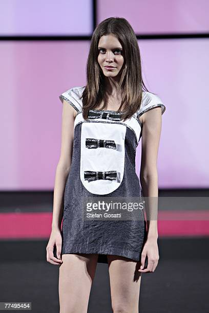 Models showcase designs by Story By Tang, Artsu, Marsha Vetolskiy, George Wu and Dhini on the catwalk at the New Generation Showcase final...