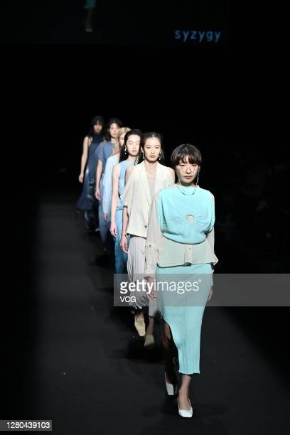 Models showcase designs by Syzygy on the runway during the 8th Asia Fashion Collection of Rakuten Fashion Week TOKYO 2021 spring/summer on October 15...