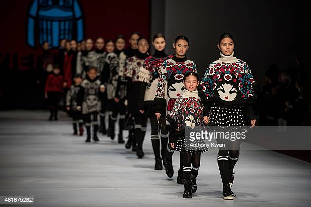 Models showcase designs by the Vivienne Tam on the runway during the Knitwear Symphony 2015 on day 3 of Hong Kong Fashion Week Fall/Winter 2015 at...