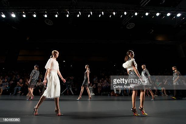 Models showcase designs by Victorio Lucchino on the runway at Victorio Lucchino show during Mercedes Benz Fashion Week Madrid Spring/Summer 2014 at...