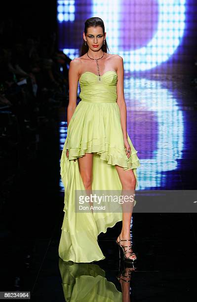 Models showcase designs by Wayne Cooper on the catwalk at the Overseas Passenger Terminal, Circular Quay on day one of Rosemount Australian Fashion...
