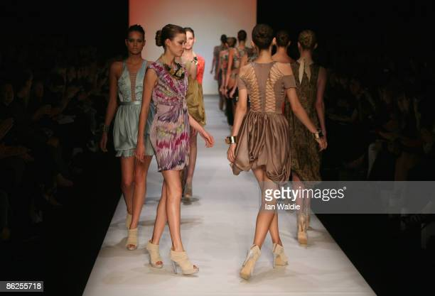 Models showcase designs by Zimmermann on the catwalk at the Overseas Passenger Terminal Circular Quay on day two of Rosemount Australian Fashion Week...