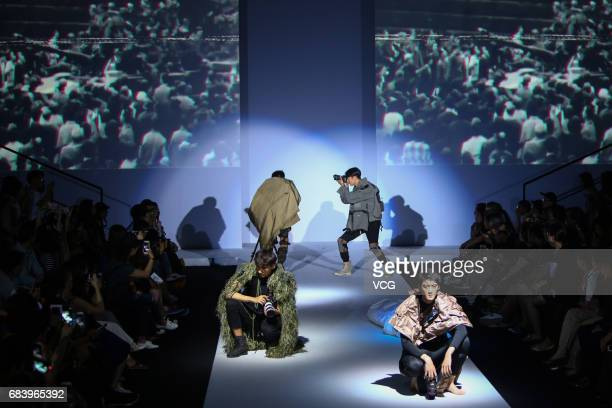 Models showcase designs designed by graduates of College of Textile and Clothing of Jiangnan University on the runway during day one of China...