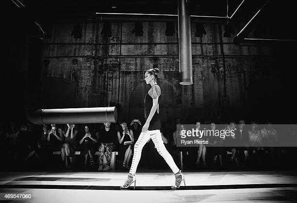 Models showcase designs during the By Johnny show at MercedesBenz Fashion Week Australia 2015 at Carriageworks on April 13 2015 in Sydney Australia