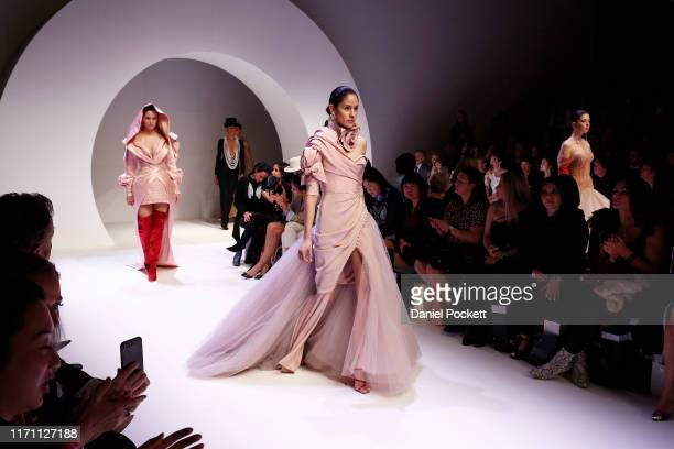 Models showcase designs during the Opening Town Hall Runway at Melbourne Fashion Week at Melbourne Town Hall on August 30 2019 in Melbourne Australia