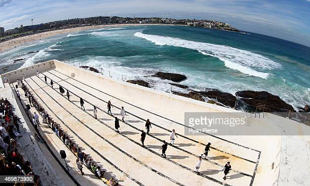 Models showcase designs during the Ten Pieces show at MercedesBenz Fashion Week Australia 2015 at Bondi Icebergs on April 16 2015 in Sydney Australia