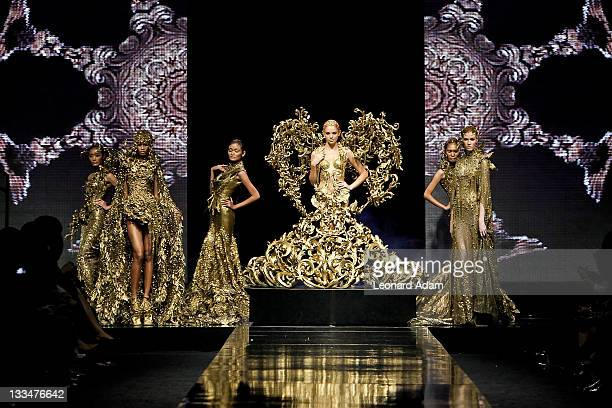Models showcase designs on the catwalk by designer Tex Savorio during Jakarta Fashion Week 2012 show at Pacific Place on November 18 2011 in Jakarta...