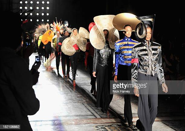 Models showcase designs on the catwalk by Philip Treacy on day 3 of London Fashion Week Spring/Summer 2013, at The Royal Courts Of Justice on...