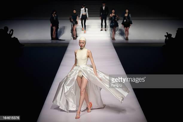 Models showcase designs on the catwalk during Hempel Award the 21st China International Young Fashion Designers Contest on the second day of...