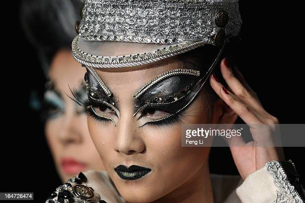 Models showcase designs on the catwalk during MGPIN Makeup Styling Collection on the fourth day of MercedesBenz China Fashion Week Autumn/Winter...