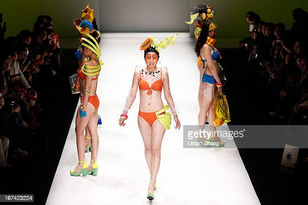Models showcase designs on the catwalk during the College of Textiles and Garments,Hebei University of Science and Technology Graduates Show on the...