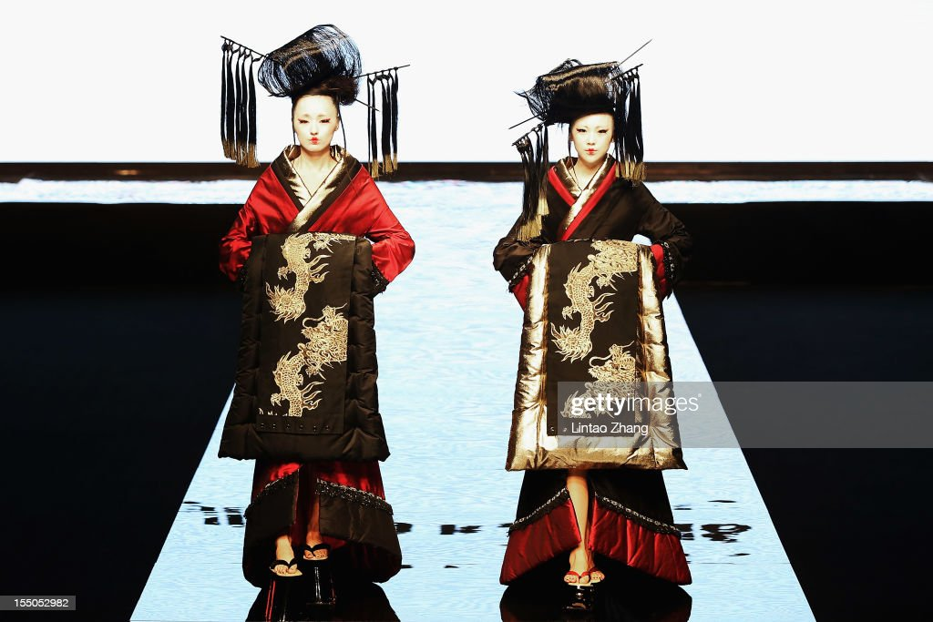 Models showcase designs on the catwalk during the East Asia Fashion Show of the China Fashion Week S/S Collection 2013 at Beijing Hotel on October 31, 2012 in Beijing, China.