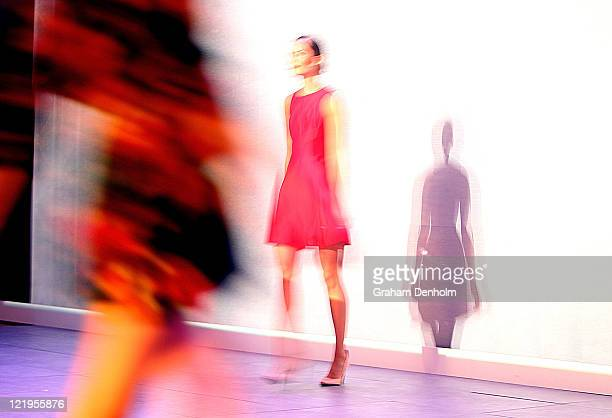 Models showcase designs on the catwalk during the Review Of Australian Fashion show as part of Mercedes Benz Fashion Festival Sydney 2011 at Sydney...
