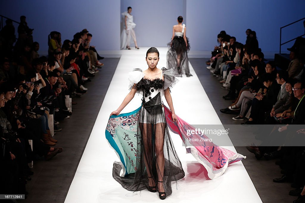 Models showcase designs on the catwalk during the School of Fashion Dalian Polytechnic University Graduates Show on the Fifth day of China Graduate Fashion Week at 751D.PARK Central Hall on April 28, 2013 in Beijing, China.