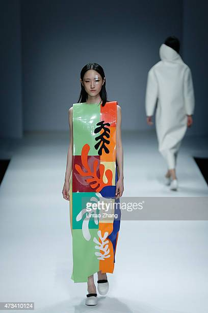 Models showcase designs on the runway at China Academy of Art School of Design Graduates Show during the day one of China Graduate Fashion Week at...