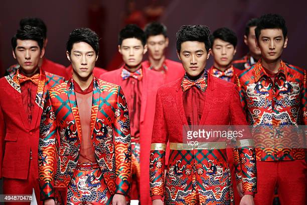 Models showcase designs on the runway at GaryWat Qu Tingnan Collection during the MercedesBenz China Fashion Week Spring/Summer 2016 at Beijing Hotel...