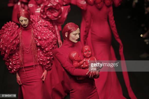 Models showcase designs on the runway at Sheguang Hu Collection during the MercedesBenz China Fashion Week Autumn/Winter 2016/2017 at 751DPark on...