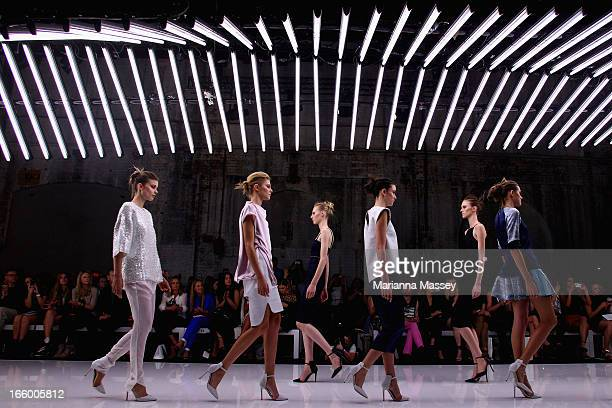 Models showcase designs on the runway at the Bec and Bridge show during MercedesBenz Fashion Week Australia Spring/Summer 2013/14 at Carriageworks on...