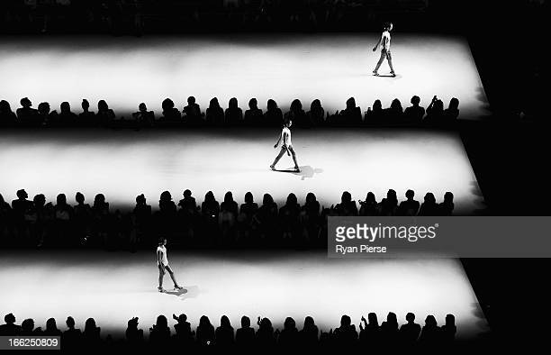 Models showcase designs on the runway at the Bless'ed Are The Meek show during MercedesBenz Fashion Week Australia Spring/Summer 2013/14 at...