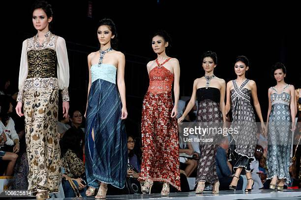 Models showcase designs on the runway by Dee Ong during the Batik 118 show on the second day of Jakarta Fashion Week 2010 at Pacific Place on...