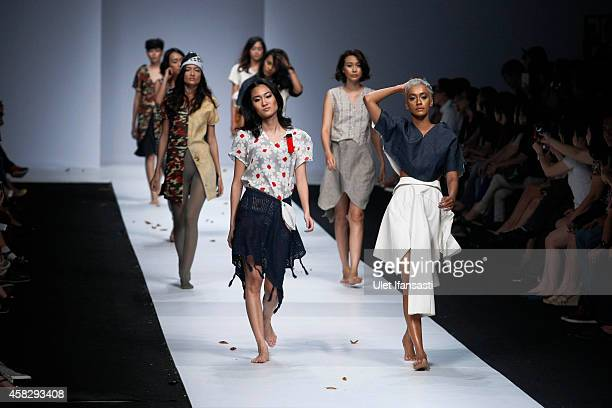 Models showcase designs on the runway by Nobis Pacem during the Jakarta Fashion Week 2015 at Senayan City on November 2 2014 in Jakarta Indonesia