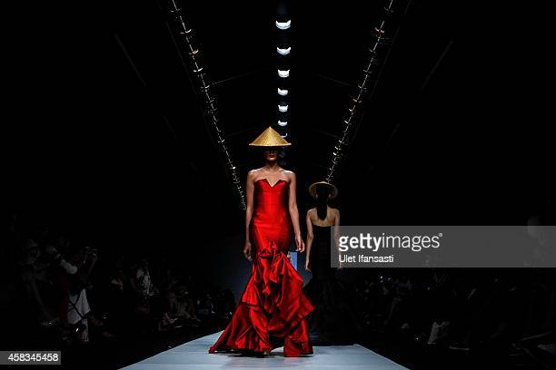 Models showcase designs on the runway by Yogie Pratama during the Jakarta Fashion Week 2015 at Senayan City on November 3 2014 in Jakarta Indonesia