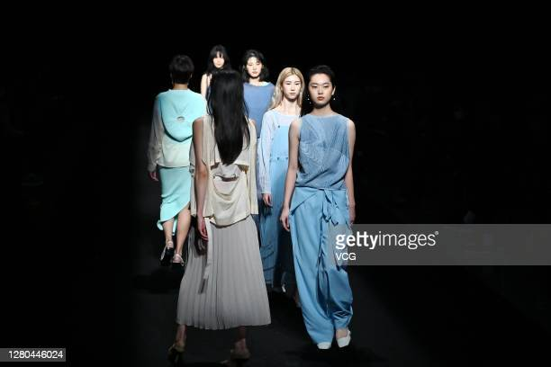 Models showcase designs on the runway during the 8th Asia Fashion Collection of Rakuten Fashion Week TOKYO 2021 spring/summer on October 15 2020 in...