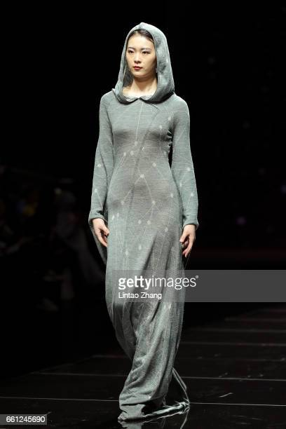 Models showcase designs on the runway during the 95sy Collection by Chinese designer Deng Zhaoping show during the MercedesBenz China Fashion Week...