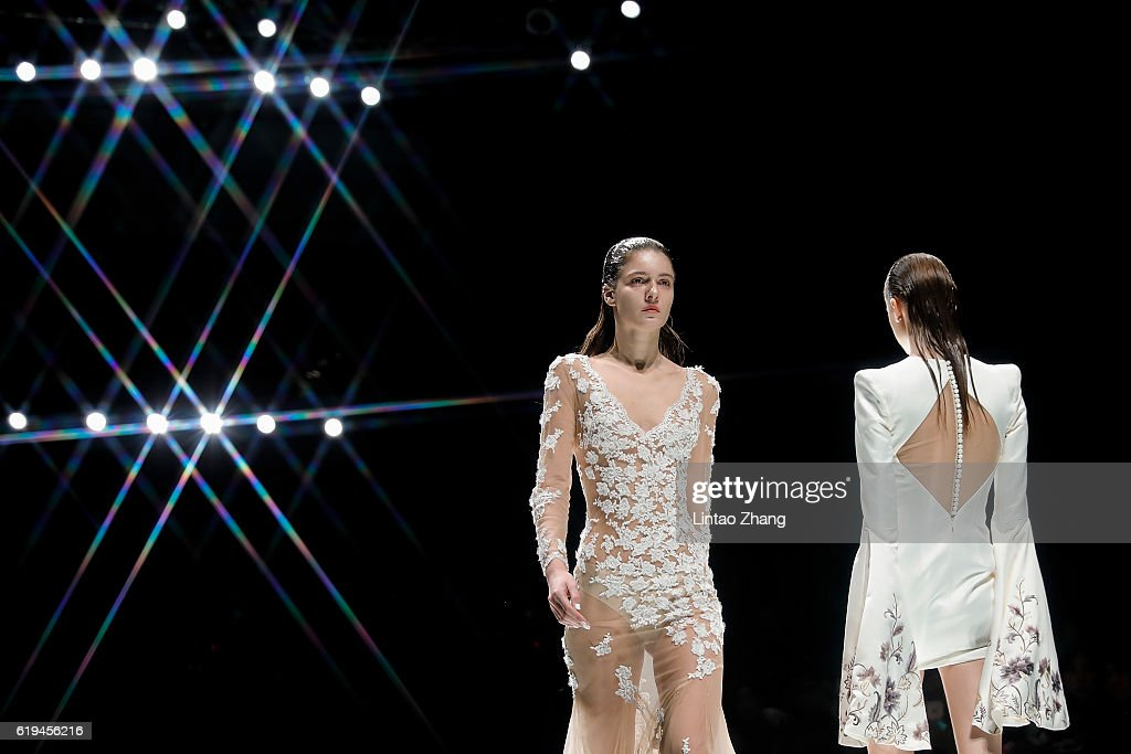 Models showcase designs on the runway during the Dennis wedding dress conference show during Mercedes-Benz China Fashion Week Spring/Summer 2017 at 751D park on October 31, 2016 in Beijing, China. China. The fashion week runs from 25 October to 02 November.