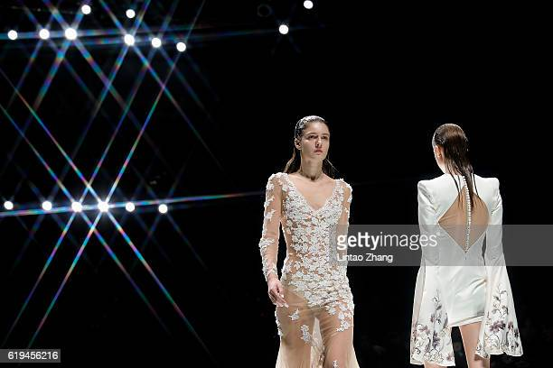 Models showcase designs on the runway during the Dennis wedding dress conference show during MercedesBenz China Fashion Week Spring/Summer 2017 at...