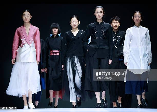 Models showcase designs on the runway during the Fashion Works by Young Teachers from BIFT show during MercedesBenz China Fashion Week Spring/Summer...