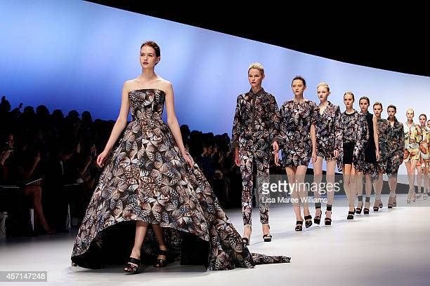 Models showcase designs on the runway during the HANAE MORI designed by Yu Amatsu show as part of Mercedes Benz Fashion Week TOKYO 2015 S/S at...